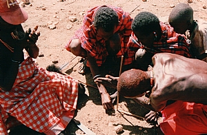 Samburu men making fire, photo by Carolyn Hancock