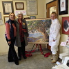 Collector, Artist and Ladybug Art Gallery Director with Pohutukawa painting