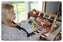 Linda Adding Fine Detail to Artwork by Linda Carr  ~  x