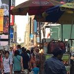 Cynthia Rosen - Street scene with umbrellas