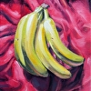 BANANAS ON RED CLOTH