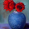 Two Red Sunflowers in Small Blue Pot